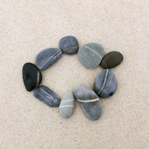 Peaceful rock meditation on the beach, West Coast, South Africa