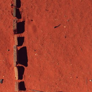 Kliplyn, Rocks collected and found on a dune, placed in a line to create shadow shapes. Upington, Northern Cape, South Africa